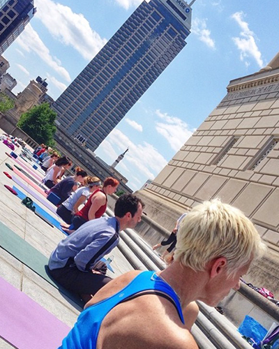 Take your yoga practice outside this summer! Invoke Studio hosts monthly sessions at the the Indiana War Memorial.