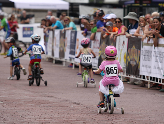 Kids can participate in a one-mile lap around the actual race course before the start of Indy Crit.